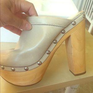Cream color chunky high heel clogs.
